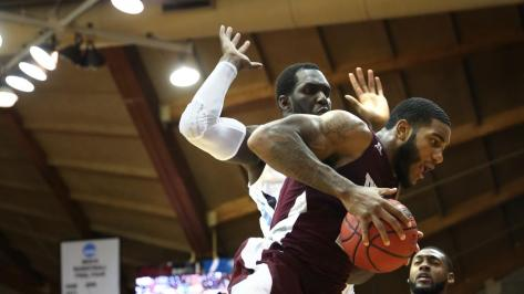 Maryland-Eastern Shore forward Mike Myers (24) grabs a rebound away from Villanova's Daniel Ochefu (23) in the first half of an NCAA college basketball game, Monday, Nov. 17, 2014, in Villanova, Pa. (AP Photo/Laurence Kesterson)