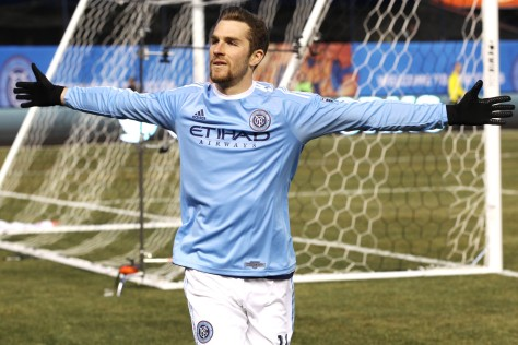 New York City FC's Patrick Mullins celebrates after scoring the team's second goal against the New England Revolution in an MLS soccer game in New York on Sunday, March 15, 2015. New York won the game 2-0. (AP Photo/Peter Morgan)