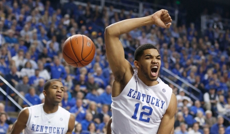 Jan 13, 2015; Lexington, KY, USA; Kentucky Wildcats forward Karl-Anthony Towns (12) celebrates after dunking the ball against the Missouri Tigers in the first half at Rupp Arena. Mandatory Credit: Mark Zerof-USA TODAY Sports