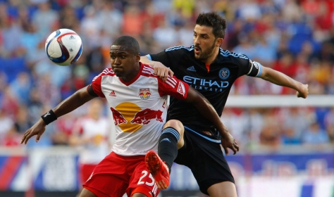 May 10, 2015; Harrison, NJ, USA;  New York Red Bulls defender Chris Duvall (25) and New York City FC forward David Villa (7) battle for the ball during first half  at Red Bull Arena. Mandatory Credit: Noah K. Murray-USA TODAY Sports